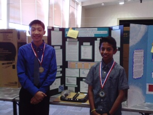 Rohan Bhushan and Christopher How stand before their winning project.  (Photo: C. Reeb)